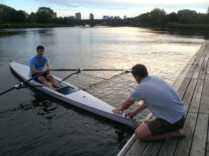 Adam Holland teaches Zachary McCune the joy of rowing.