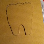 First, cut a tooth stencil.